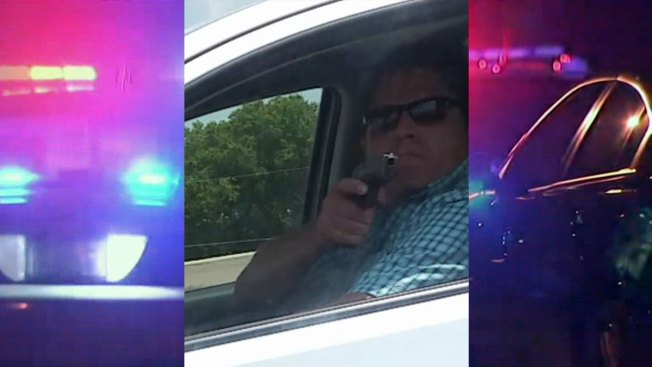 Texas police hunt driver who pointed gun at woman on highway