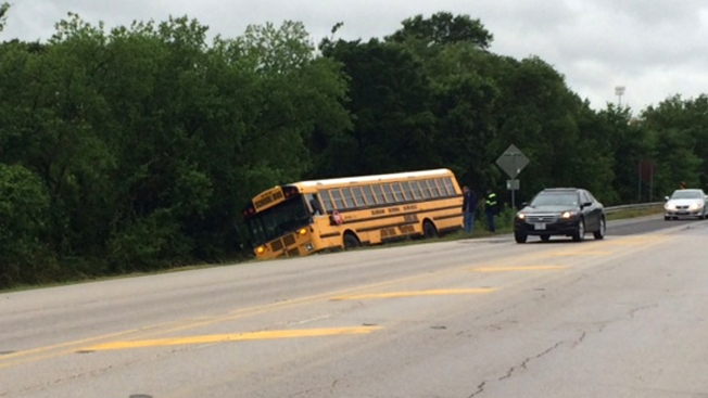 Swift Water Pushes Northwest ISD Bus Off Road