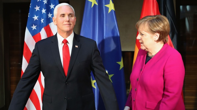 Merkel Defends Iran Deal, Multilateralism But Pence Resists