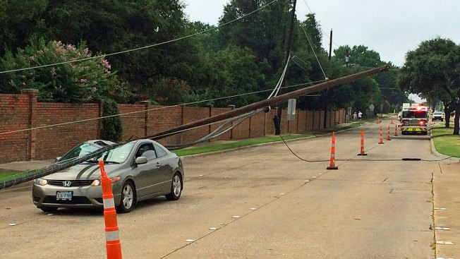 Driver Freed After Live Power Lines, Pole Crash Down on Car