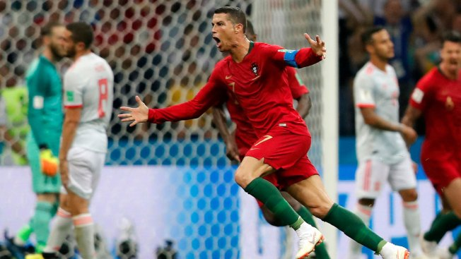 d5045fdb3af World Cup  Ronaldo Scores Hat Trick as Portugal Draws Spain. AP. Portugal s  Cristiano Ronaldo celebrates after he scored his third goal with ...