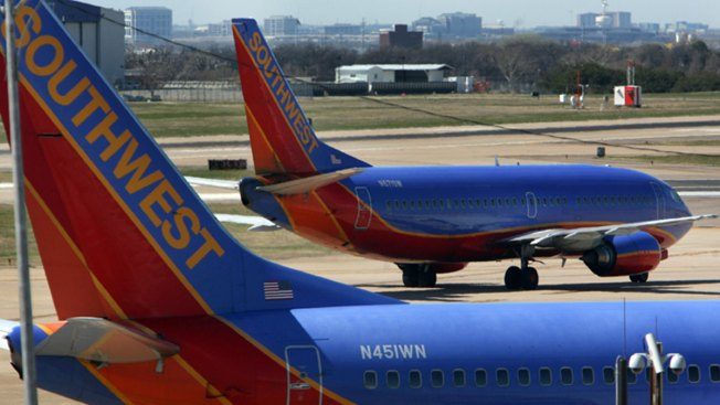 S&P Unit Downgrades Southwest Airlines to 'Hold'