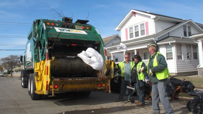 Two Garbagemen Bring Hope to Family of a Little Girl With Cancer