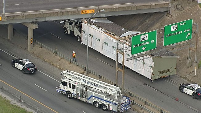 Truck Carrying Modular Home Hits Bridge Along East Loop 820