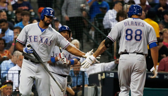 Wandy Rodriguez Helps Rangers to 7-1 Win Over Astros