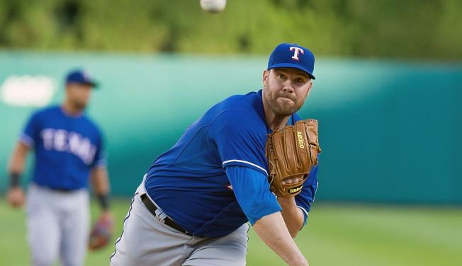 Colby Lewis Leads Rangers Shutout Win in Detroit