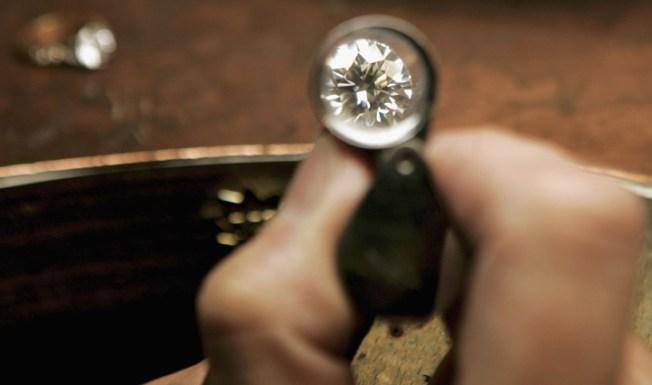 """Lawsuit: Power Company Deals in """"Blood Diamonds"""""""