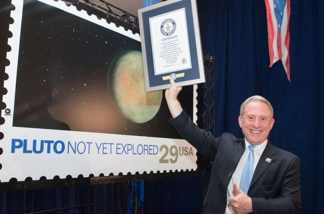 Little Postage Stamp Travels All the Way to Pluto