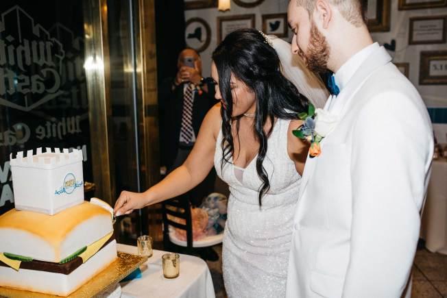 couple celebrates wedding with white castle theme