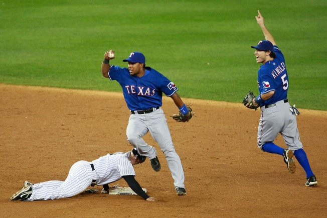 Rangers Hold Off Yankee Rally