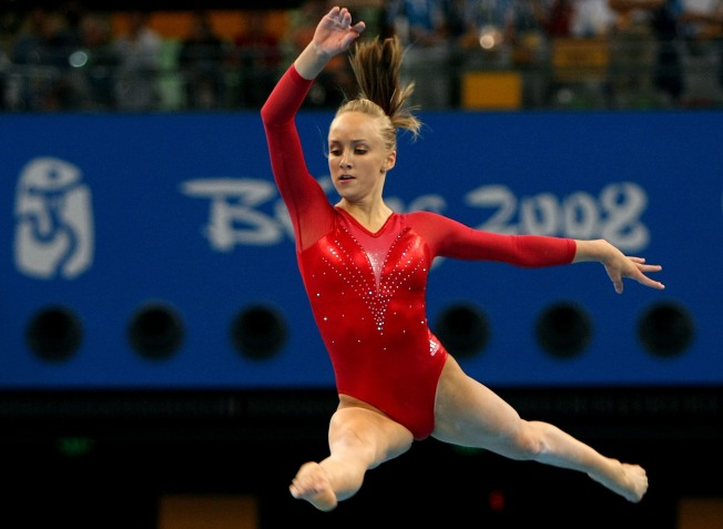 Golden Girl Liukin Teams Up With Girl of Steel