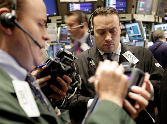 Dow Ends Up After Roller-Coaster Day