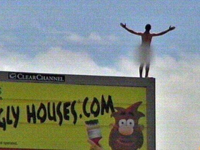 Naked Man Leaves Billboard Perch