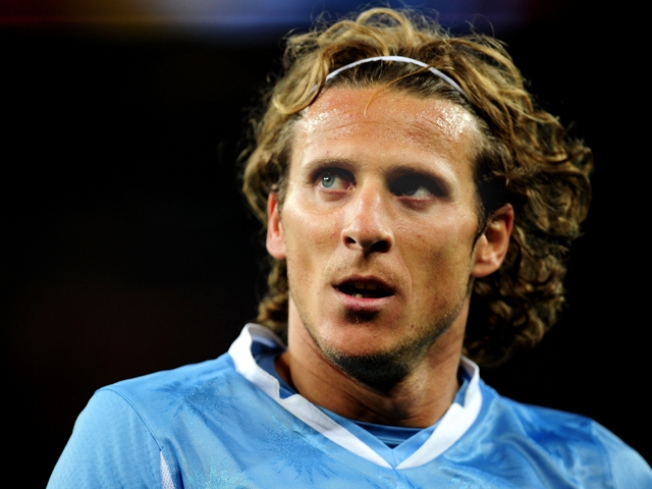 Forlan Deals with Injury, Devastated by Loss