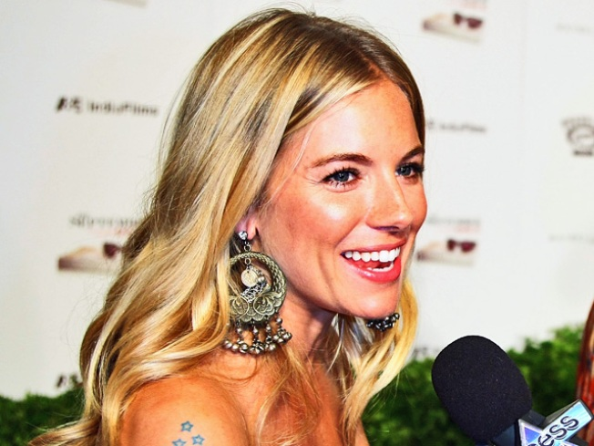 Sienna Miller to Sue Rupert Murdoch-Owned Paper Over Phone Taps