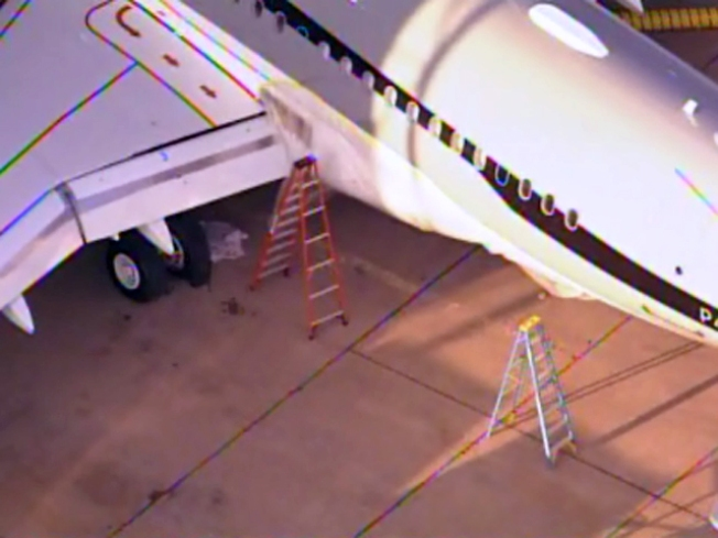 Plane Drops Emergency Slide on Dallas