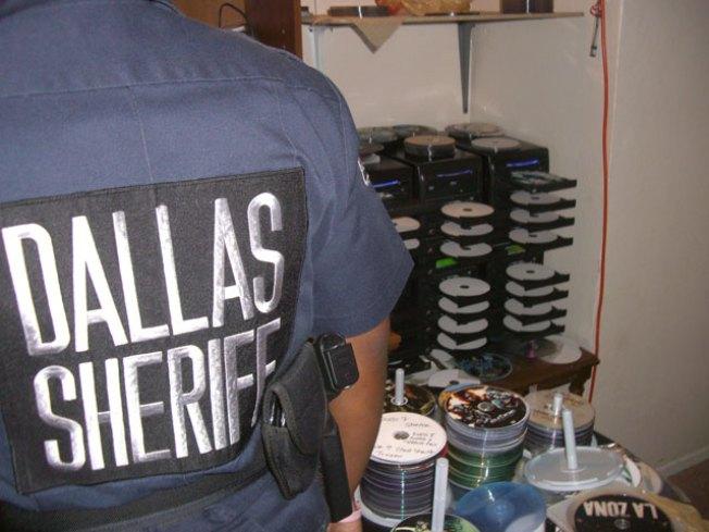 Bootleg Raid Nets 10,000 Illegal Movies, CDs