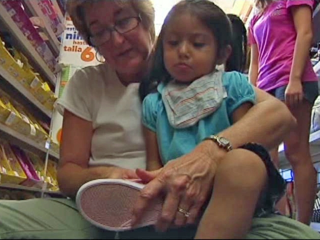 "Families Benefit From Back-To-School ""Shoe Rally"""