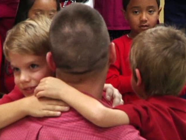 Soldier Surprises Sons With Holiday Homecoming
