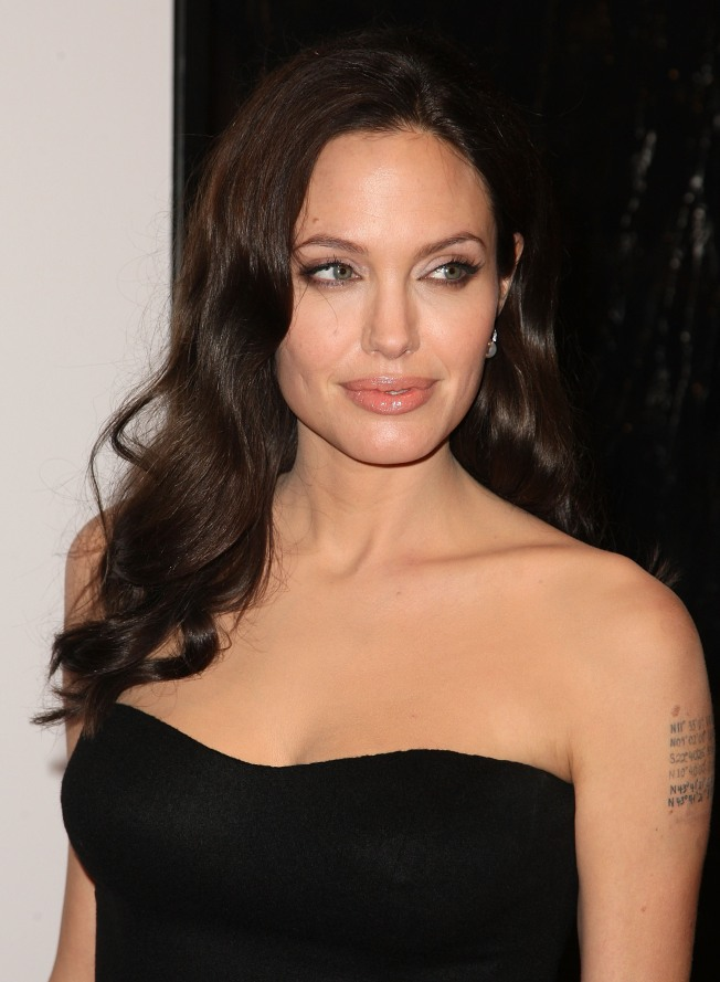Angelina's New Additions: Tattoos