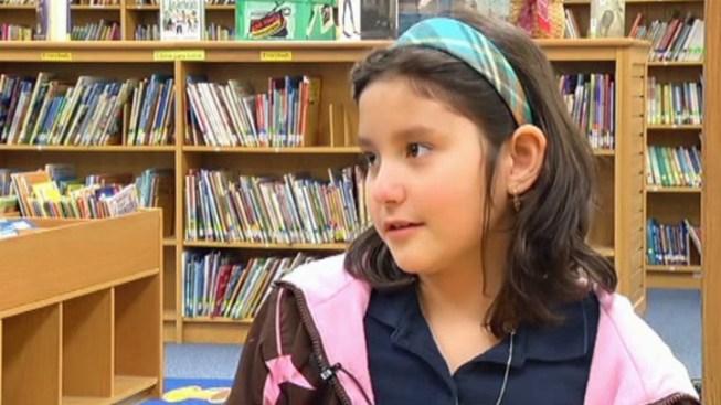 Girl Donates Piggy Bank to Save Teachers' Jobs