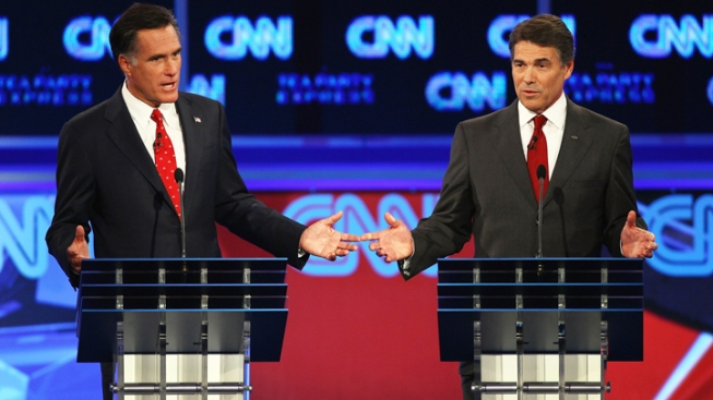 Perry Likens Romney to a Liberal