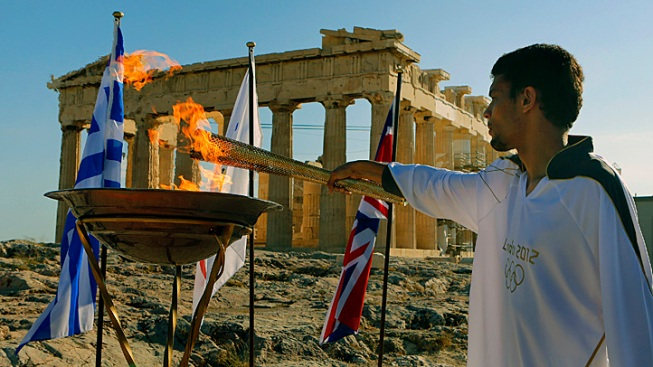 Olympic Flame Handed Over to U.K.