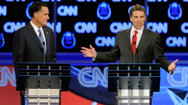 N.H. Shows Contrasts Between Perry, Romney