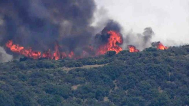 Flames Race Across Rural Northern California, Thousands Flee