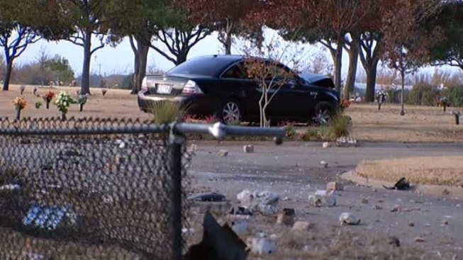 Car Crashes into Cemetery