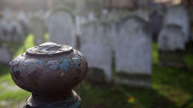 One Stabbed, Another Hit With Urn in Cemetery Fight
