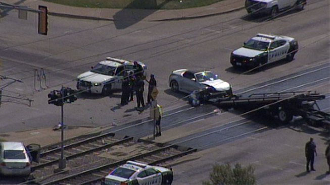 Car Accident Lands on DART Rail Tracks