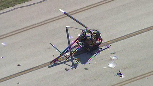Two Escape Chopper Crash Uninjured