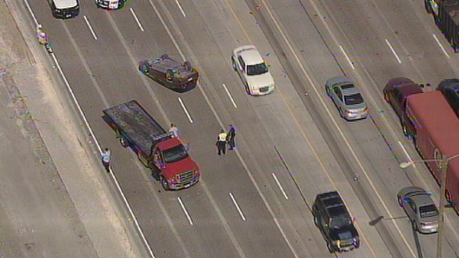 Overturned Car Backs Up LBJ