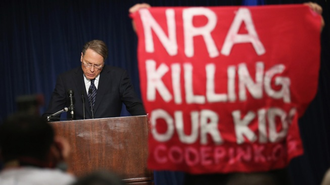 NRA Calls for Armed Police Officer in Every School, Blames Culture of Violence for Shootings