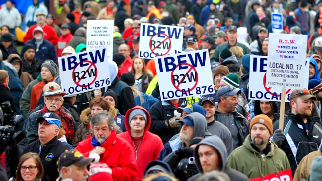 "Mich. Governor Signs ""Right-to-Work"" Bills Over Protests"