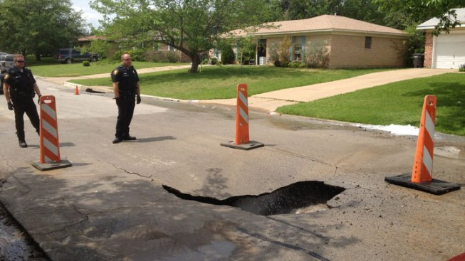 Road Collapses Above Water Main Break