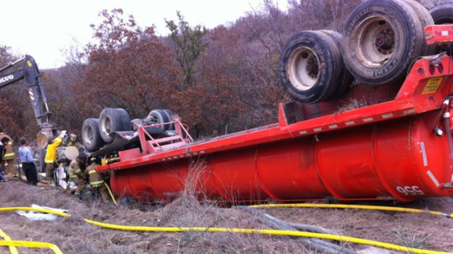 Water Tanker Overturns, Trapping Driver