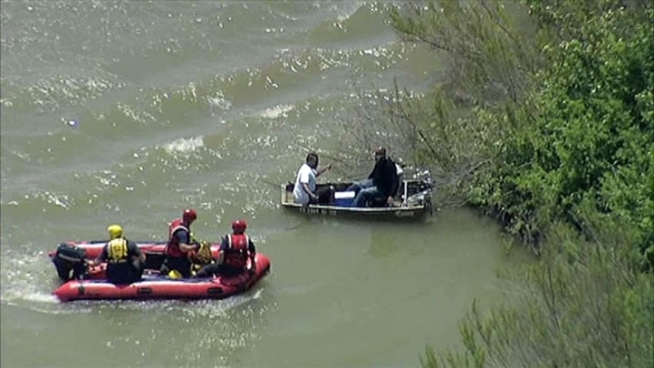 Dallas Fire-Rescue had to come to the aid of two men when the aluminum boat they were in flipped and filled with water.