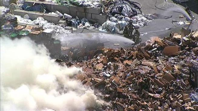 Fire in a mountain of trash kept firefighters busy Monday at a Carrollton recycling plant.
