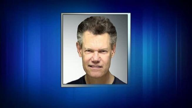 Country singer Randy Travis was arrested for public intoxication in Sanger, TX.