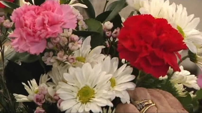 On the busiest day of the year, local florists rush to complete orders for Valentine's Day.
