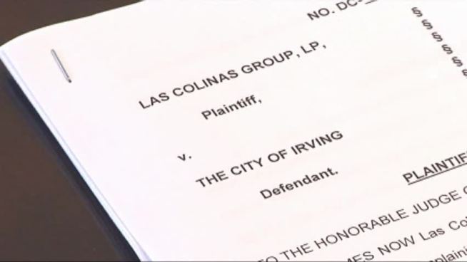 Irving faces a lawsuit from the Las Colinas Group after the City Council voted 5-4 to decline a contract extension for the proposed Irving entertainment center.