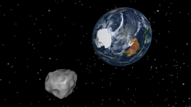 The asteroid dubbed 2012 DA14, shown here in a NASA simulation, will zoom by Earth on Friday.