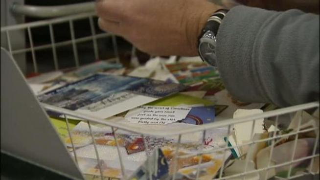 Community members in Carrollton recycle their Christmas cards.
