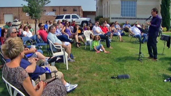 The 100-member Crosspointe Church congregation gathered for services Sunday a few feet from their building four days after lightning destroyed it.