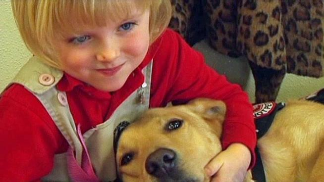 Five-year-old Lily Simonton's diabetic alert dog Charlie gives her mother and teachers peace of mind and she says he saves her life.