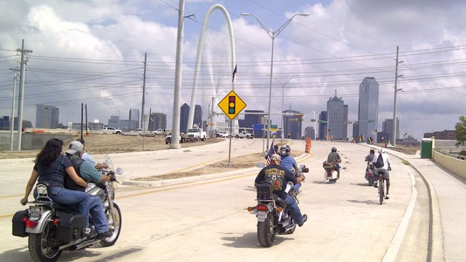The first vehicles, motorcycles and a Vespa, rolled eastbound toward downtown Dallas at around 1 o'clock Thursday afternoon. The bridge will open in stages.
