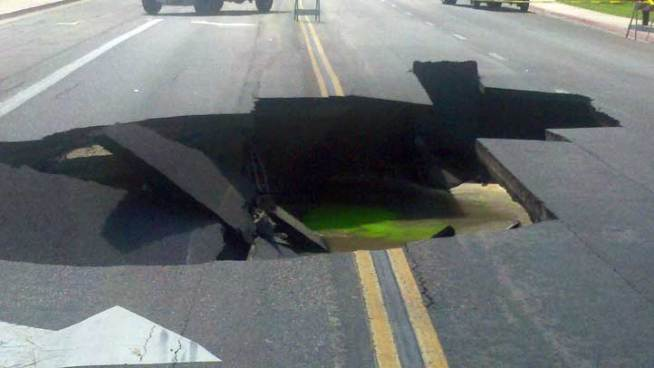 Teen on Street Corner Swallowed by Sinkhole