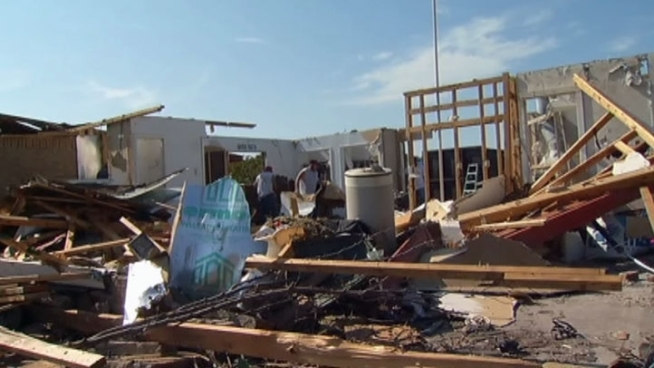Residents in Lancaster are still cleaning up, repairing, and rebuilding one month after an EF2 tornado tore through their town April 3.
